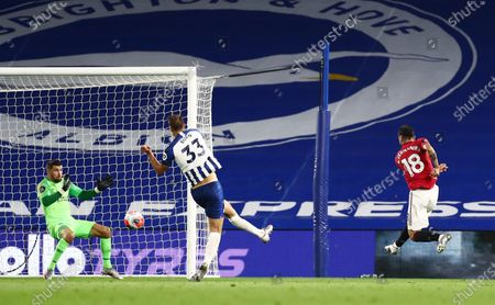 Bruno Fernandes of Manchester United scores his sides third goal.
