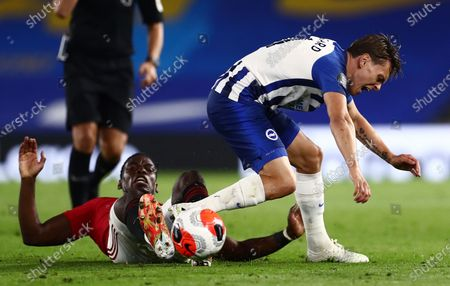 Leandro Trossard of Brighton & Hove Albion is fouled by Paul Pogba of Manchester United.