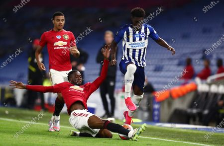 Yves Bissouma of Brighton & Hove Albion is tackled by Aaron Wan-Bissaka of Manchester United.