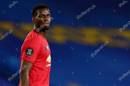 Paul Pogba of Manchester United appears to wink.