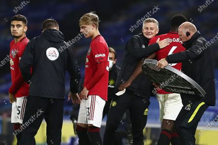 Manchester United Manager Ole Gunnar Solskjaer smiles as Paul Pogba of Manchester United is substituted.