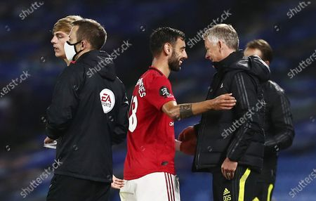 Manchester United Manager Ole Gunnar Solskjaer smiles as Bruno Fernandes of Manchester United is substituted.