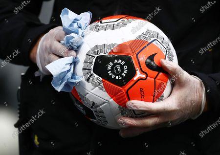 A nike Premier League football is cleaned.