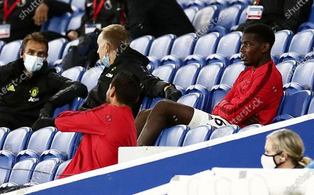 Paul Pogba of Manchester United sits in the stand after being substituted.