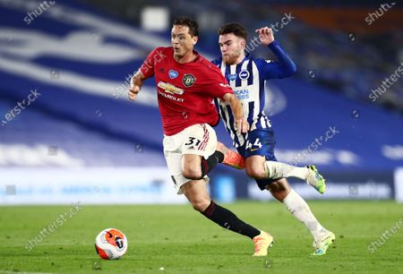 Nemanja Matic of Manchester United and Aaron Connolly of Brighton & Hove Albion.