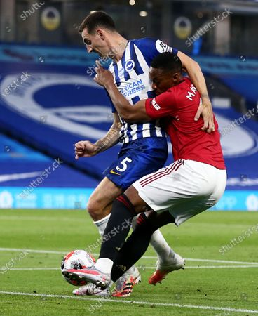 Anthony Martial of Manchester United and Lewis Dunk of Brighton & Hove Albion.
