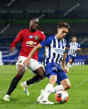 Leandro Trossard of Brighton & Hove Albion and Aaron Wan-Bissaka of Manchester United.