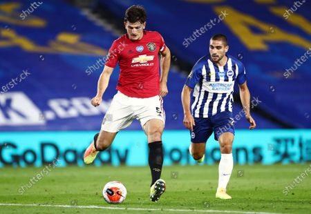 Harry Maguire of Manchester United and Neal Maupay of Brighton & Hove Albion.