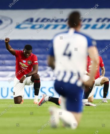 Paul Pogba of Manchester United takes a knee.