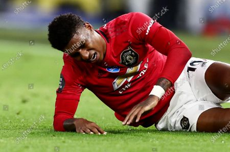 Stock Photo of Marcus Rashford of Manchester United is seen on the floor after being fouled.
