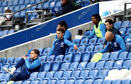 Stock Image of Brighton substitutes are seen in the stands.