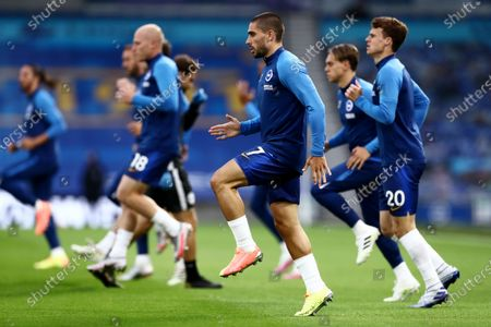 Neal Maupay of Brighton & Hove Albion and team mates warm up.