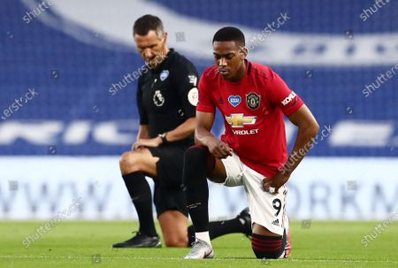 Anthony Martial of Manchester United takes a knee.