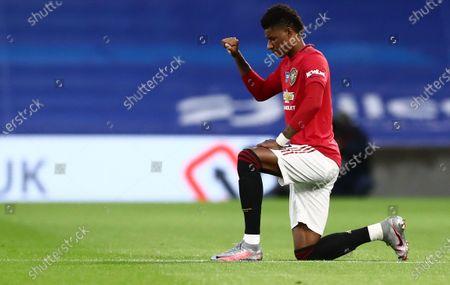 Marcus Rashford of Manchester United takes a knee.