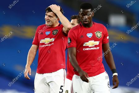 Harry Maguire of Manchester United rubs his head.