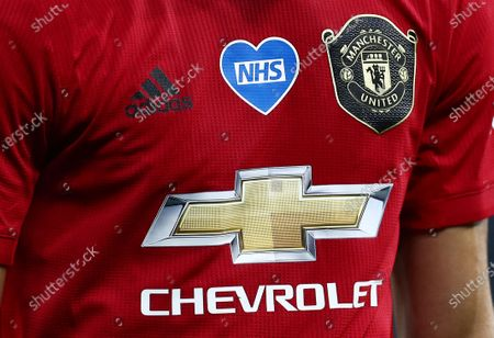 A close up of the NHS badge on the Manchester United shirt.