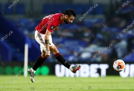 Bruno Fernandes of Manchester United plays the ball forward.