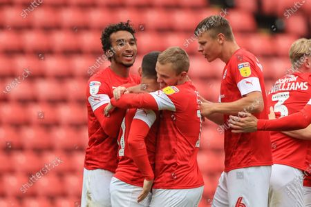 Conor Chaplin (11) of Barnsley celebrates his goal to make it 1-0 with team mates