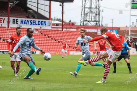 Cauley Woodrow (9) of Barnsley shoots on goal