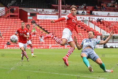 Patrick Schmidt (19) of Barnsley back heels a shot on goal