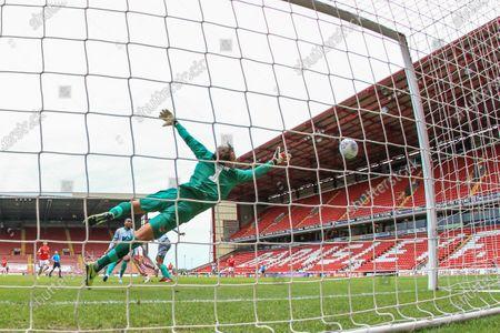Conor Chaplin (11) of Barnsley scores past Christian Walton (1) of Blackburn Rovers to make it 1-0