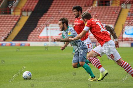 Adam Armstrong (7) of Blackburn Rovers makes break closely followed by \b18 and Alex Mowatt (27) of Barnsley