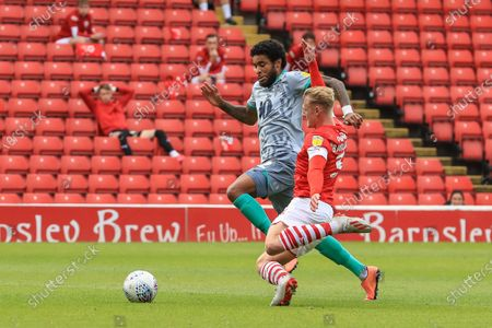 Ben Williams (3) of Barnsley chases down Dominic Samuel (12) of Blackburn Rovers to slide in and win the ball
