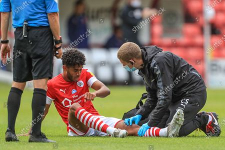 Romal Palmer (41) of Barnsley receives treatment for his knee injury