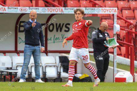 Callum Styles (20) of Barnsley gives his team instructions