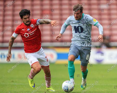 Joe Rothwell (8) of Blackburn Rovers breaks and Alex Mowatt (27) of Barnsley gives chase