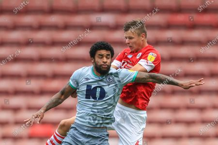 Mads Andersen (6) of Barnsley and Dominic Samuel (12) of Blackburn Rovers battle for the ball