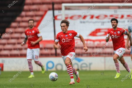 Stock Photo of Callum Styles (20) of Barnsley  breaks down the middle with the ball
