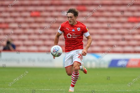 Stock Image of Callum Styles (20) of Barnsley breaks wit the ball