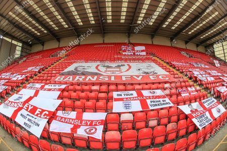 Barnsley flags are scattered out over the Ponty End as tonights game is played behind closed doors
