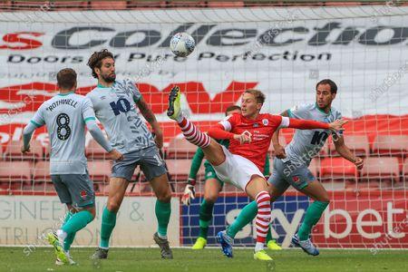 Cauley Woodrow (9) of Barnsley with an early effort on goal