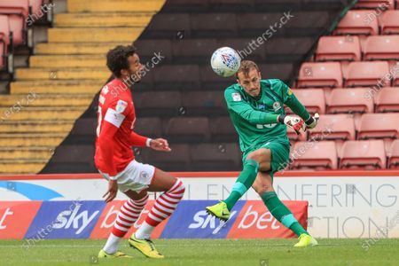 Christian Walton (1) of Blackburn Rovers clears the ball as Jacob Brown (7) of Barnsley pressures
