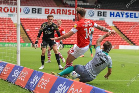 Michael Sollbauer (18) of Barnsley is fouled by Adam Armstrong (7) of Blackburn Rovers