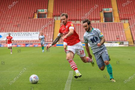 Michael Sollbauer (18) of Barnsley wins the ball from Adam Armstrong (7) of Blackburn Rovers