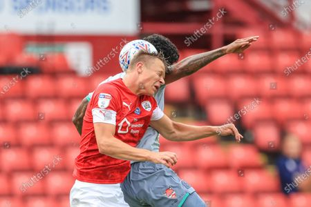 Mads Andersen (6) of Barnsley and Dominic Samuel (12) of Blackburn Rovers dual for the ball