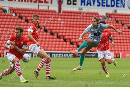 Michael Sollbauer (18) of Barnsley blocks Lewis Holtby (22) Of Blackburn Rovers shot on goal