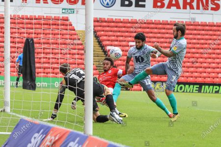 Jacob Brown (7) of Barnsley clears a rebounded shot off his goal line as Dominic Samuel (12) of Blackburn Rovers and Adam Armstrong (7) of Blackburn Rovers pressures