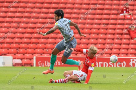 Ben Williams (3) of Barnsley chases down Dominic Samuel (12) of Blackburn Rovers to slide in and win the ball, great defending by Williams