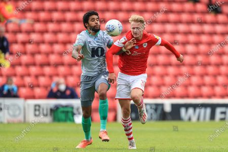 Ben Williams (3) of Barnsley and Dominic Samuel (12) of Blackburn Rovers dual for the ball