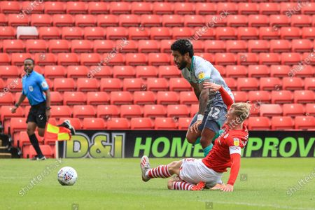Ben Williams (3) of Barnsley slides in to the the ball from Dominic Samuel (12) of Blackburn Rovers for the third successful time in the game, Williams is having a great game
