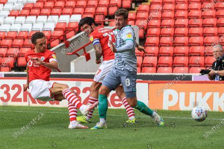 Jordan Williams (2) of Barnsley clears the ball from Joe Rothwell (8) of Blackburn Rovers