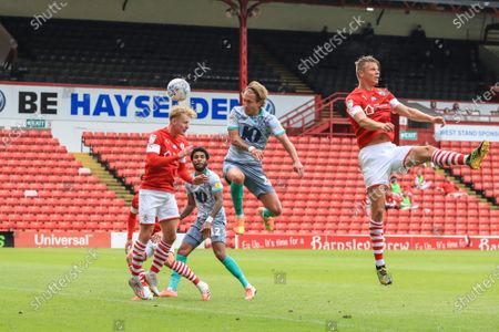 Ben Williams (3) of Barnsley heads a crossed ball put for a corner as Lewis Holtby (22) Of Blackburn Rovers pressures