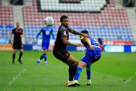 Jordan Cousins (24) of Stoke City tries to get past Antonee Robinson (3) of Wigan Athletic