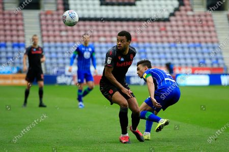 Jordan Cousins (24) of Stoke City and Antonee Robinson (3) of Wigan Athletic challenge for the ball