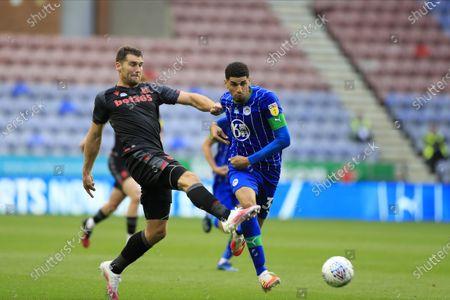 Sam Vokes (9) of Stoke City passes the ball beyond Leon Balogun (37) of Wigan Athletic