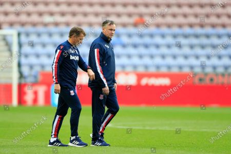 Stoke City manager Michael O'Neill walks to the dressing room at half time with his team being beaten 1-0